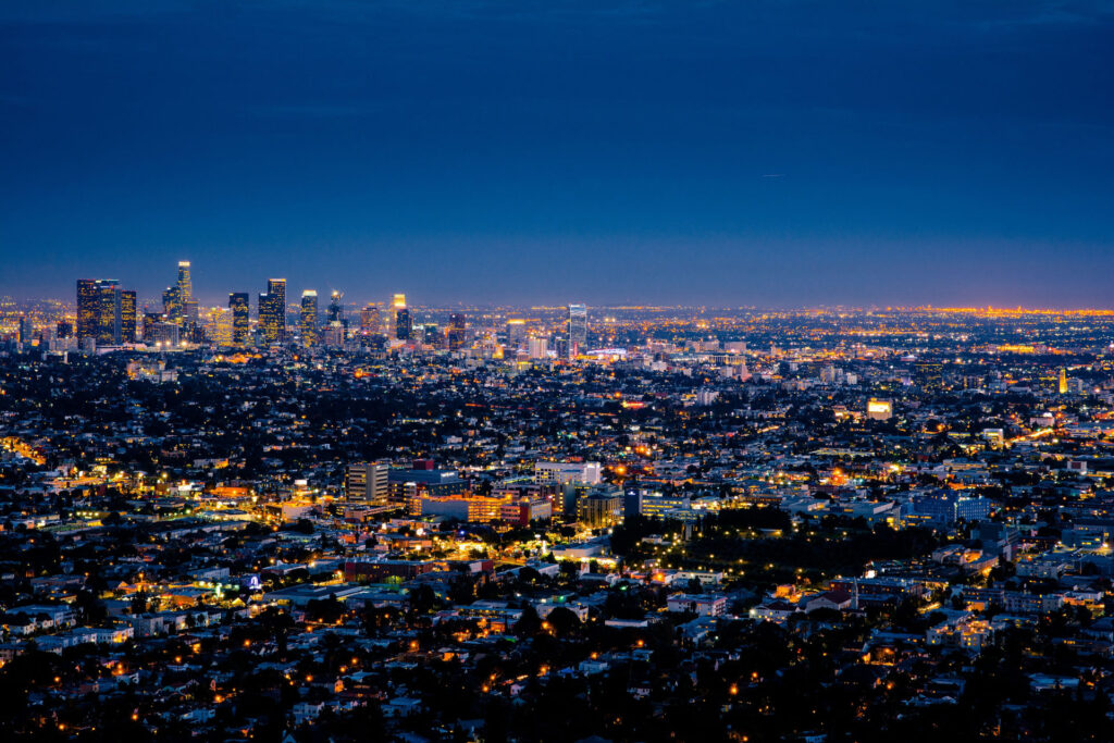 the city of los angeles at night from a hill