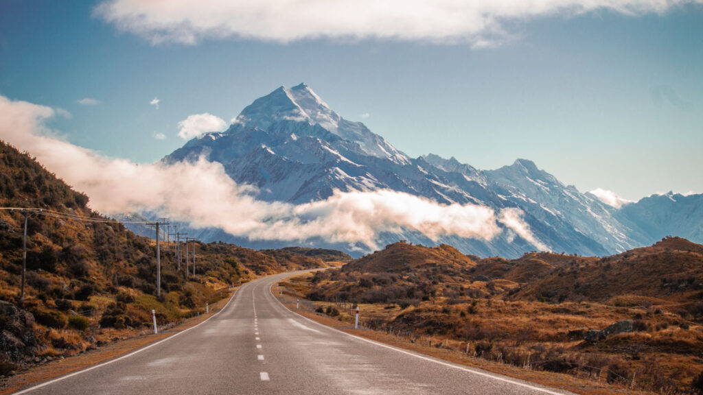 road heading towards a snowy mountain